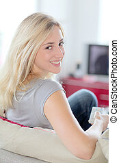 Woman at home watching television