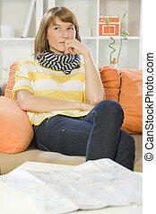 woman at home with travel map