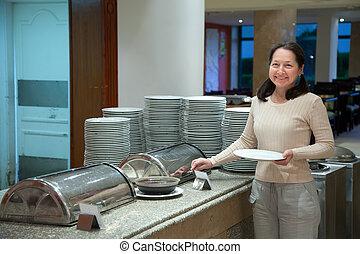 Woman at hotel buffet