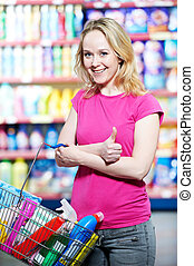woman at household chemistry shopping - woman choosing ...