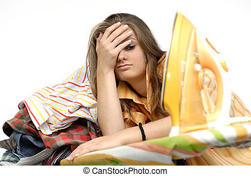 Frustrated young woman at a ironing board