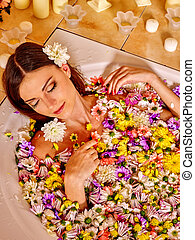 Woman at luxury spa. - Woman relaxing at water spa. Aqueous ...