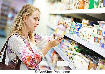 woman at milk dairy shopping
