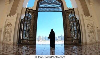 Woman at Mosque Doha - Woman with abaya dress looks at views...