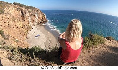 Woman at Pirates Cove promontory - Caucasian female looks...