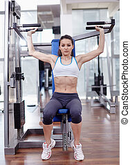 Woman at shoulder press