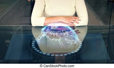 woman at smart screen and virtual earth projection -...