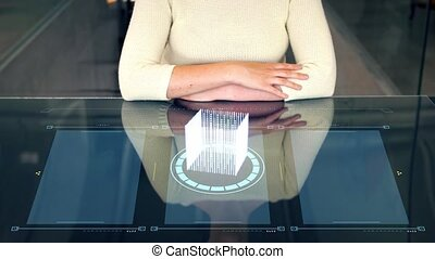 woman at smart screen and virtual projection - programming...