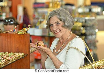 Woman at souvenir store