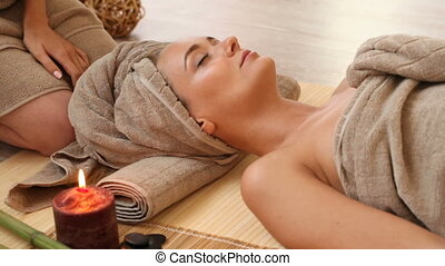Woman at spa session - woman getting massage at spa session