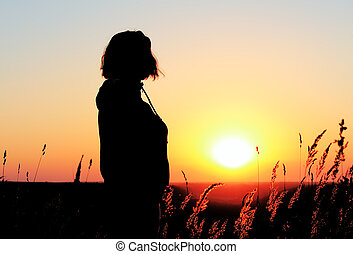 Woman at sunset