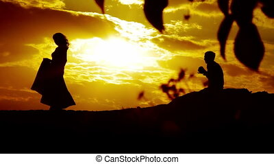 Woman at Sunset Poses For a Photograph