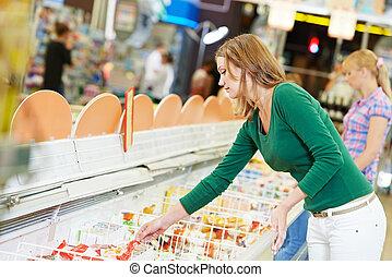 woman at supermarket dairy shopping