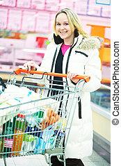 woman at supermarket shopping
