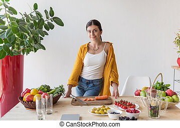 woman at table with organic food