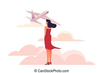 Woman at the airport standing and looking at an airplan.