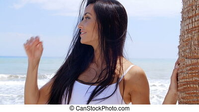 Woman at the Beach Smiling Over her Shoulder