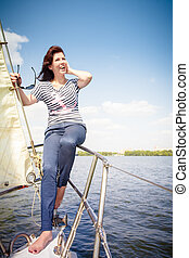 woman at the bow of the yacht