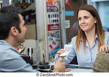 woman at the cash desk