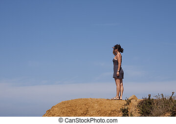 Woman at the cliff