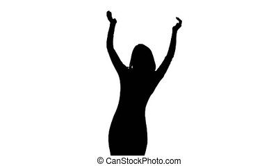 Woman at the concert is dancing and hands up claps. White background. Silhouette