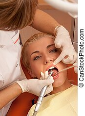 Woman at the dentist's surgery.