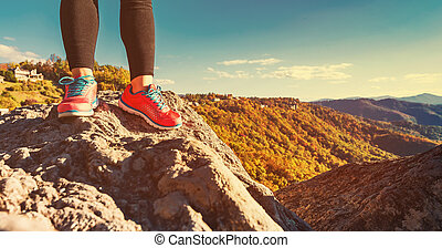 Woman at the edge of a cliff