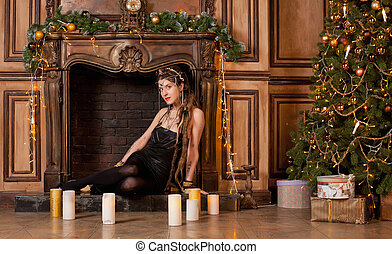 Woman at the fireplace