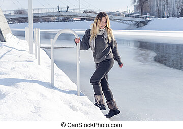 Woman at the frozen river