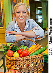 a young woman buying fruits and vegetables at a weekly market. fresh and healthy diet.