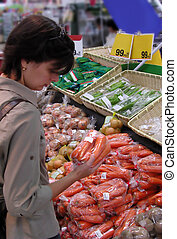 Woman at the greengrocery - Woman shopping in a supermarket ...