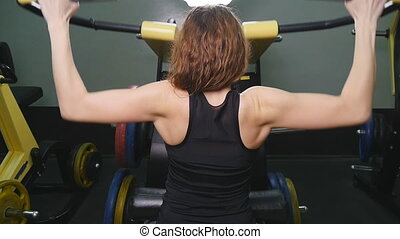Woman at the gym working out