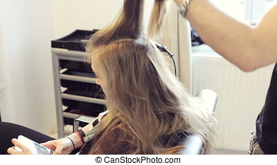 Woman at the hair saloon getting ready for party