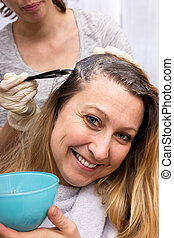 Woman at the hairdresser - Woman is happy visiting the...