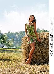 Woman at the haystack