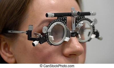Woman at the reception of an ophthalmologist. Eye...