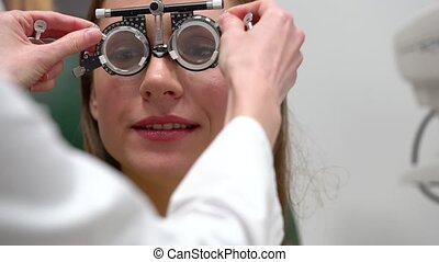 Woman at the reception of an ophthalmologist. Eye examination and selection of spectacle lenses. Close-up