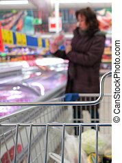 Woman at the supermarket with cart