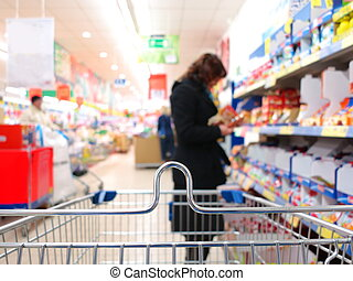 Woman at the supermarket with trolley