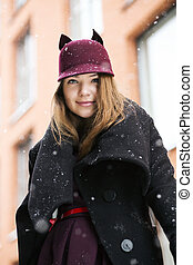 Woman at winter day with funny hat