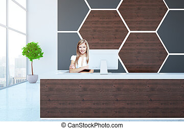 Woman at wooden reception