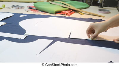 woman at work as fashion designer and tailor. Fashion designer working on table. close up