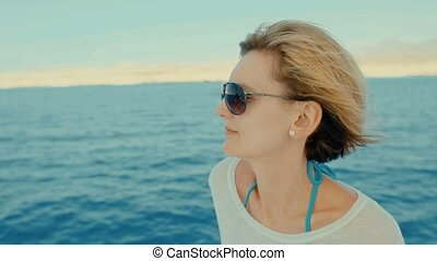 Woman at yacht - Profile closeup of a woman enjoying trip on...