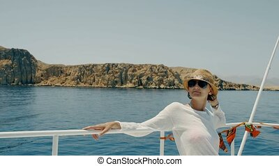 Woman at yacht - Woman enjoying a trip on yacht sitting on...