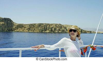 Woman at yacht - Profile closeup of a woman enjoying trip on...