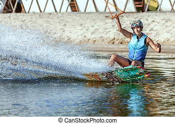 Woman athlete on a wakeboard.