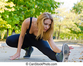 Woman athlete warming up