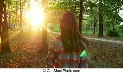 Woman autumn walking park