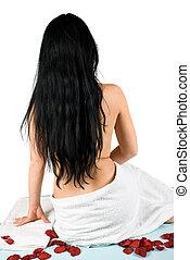 Woman back at spa massage