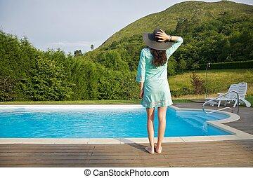 woman back in swimming pool border